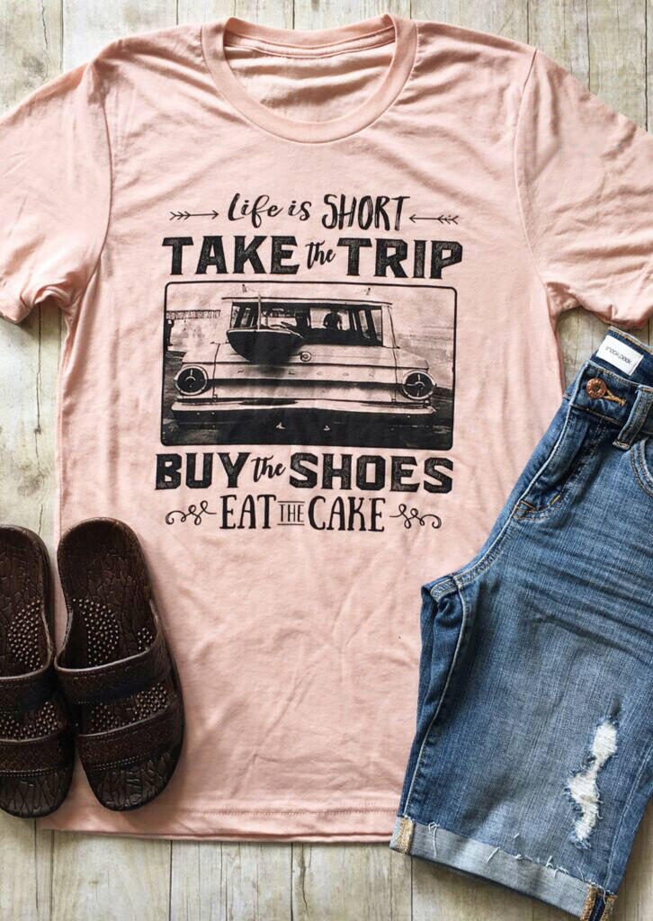 Life Is Short Take The Trip Buy The Shoes Eat The Cake T-Shirt in Pink. Size: S,M,L,XL,2XL,3XL фото