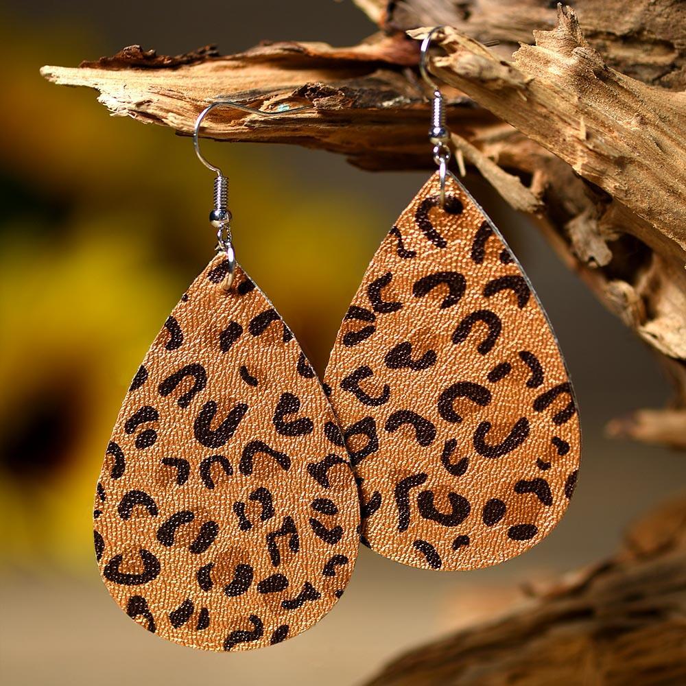 Earrings Leopard Printed Leather Earrings in #2. Size: One Size фото