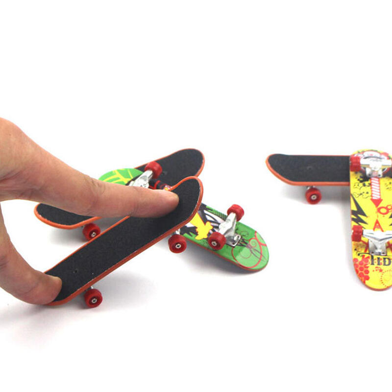 Hobbies and Toys Mini Finger Skateboard фото