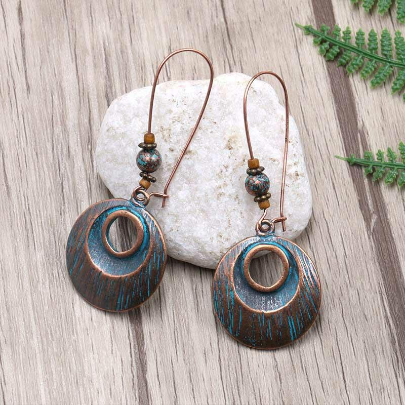 Fairyseason coupon: Bohemian Hollow Out Circle Pendant Earrings